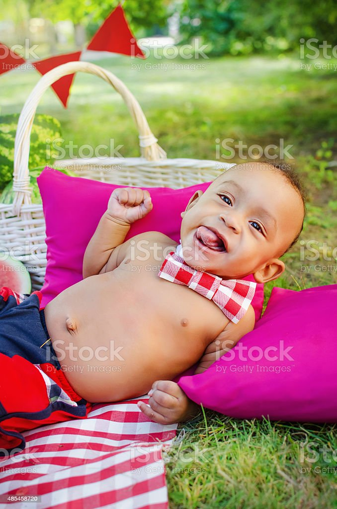 cheerful baby boy on grass stock photo