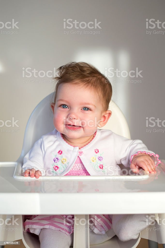 Cheerful Baby in Highchair stock photo
