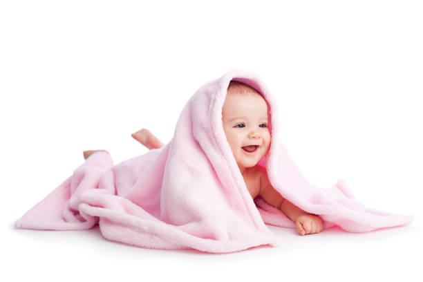 Cheerful baby in white background Cheerful baby in white background baby blanket stock pictures, royalty-free photos & images