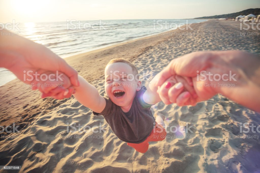 Cheerful babySpinning boy stock photo