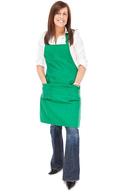 Cheerful Barista in Green Apron stock photo