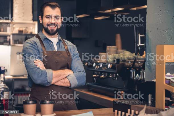Cheerful barista working in cafe picture id874875396?b=1&k=6&m=874875396&s=612x612&h=fpbowshevt8arcp ajztj8hq3mrg  rhdovnbrc36ry=
