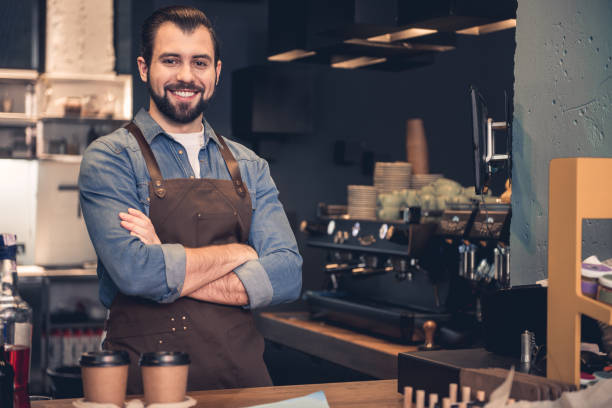 cheerful barista working in cafe - barista making coffee stock pictures, royalty-free photos & images