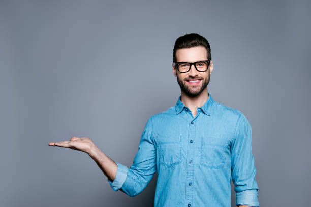 cheerful bearded man in glasses making advertisement of new product - man made object stock photos and pictures