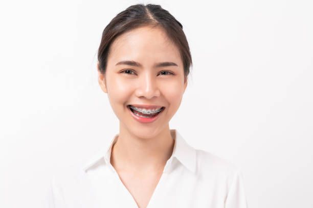Cheerful beautiful Asian woman stand and smile on white background. stock photo