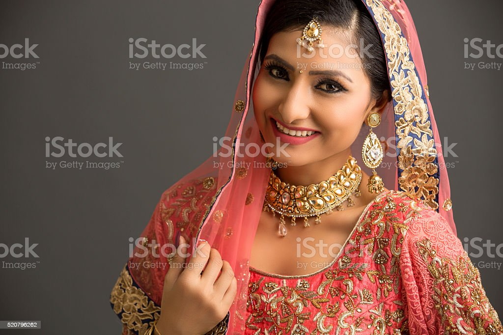 Cheerful beautiful woman in glamorous outfit and jewelry stock photo