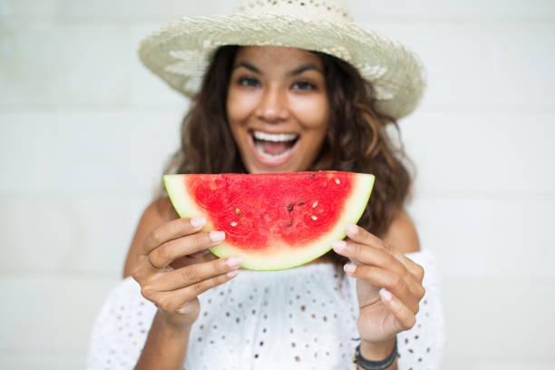 Cheerful Beautiful Woman With Slice of Watermelon stock photo