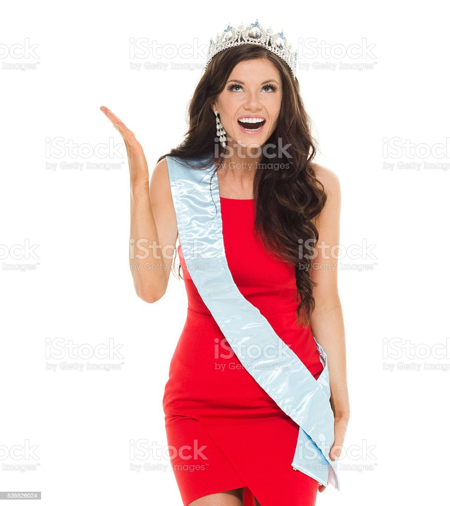Cheerful beauty queen looking surprised stock photo