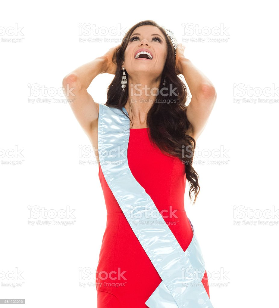 Cheerful beauty queen looking up stock photo