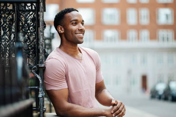 Cheerful black guy in London stock photo
