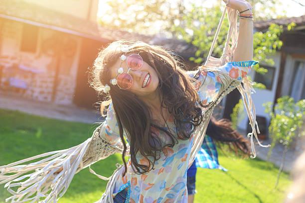 cheerful boho woman dancing on grass - hippie stirnbänder stock-fotos und bilder