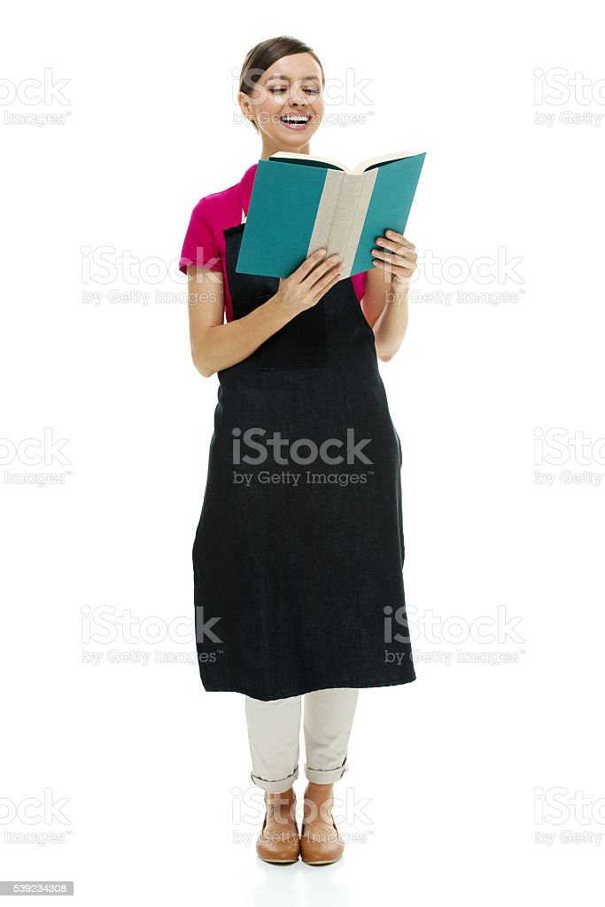 Cheerful bookseller reading book royalty-free stock photo