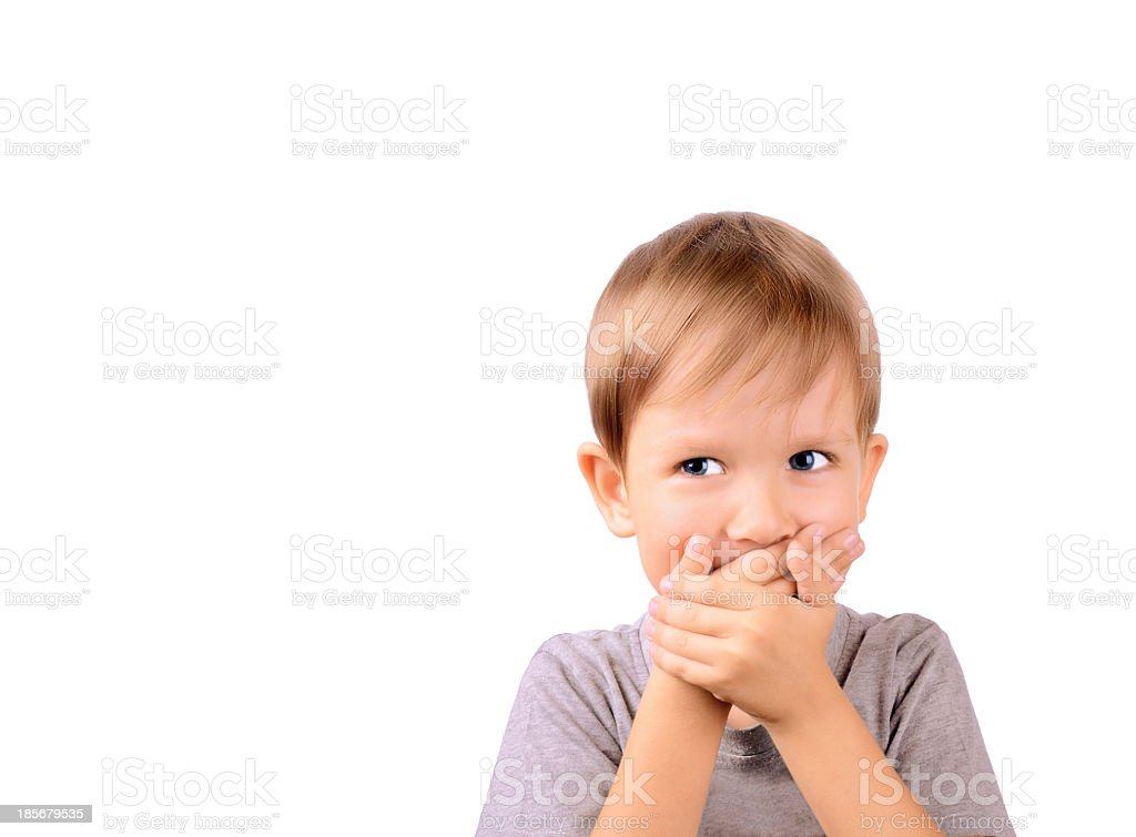 cheerful boy 5 years shut by the hands mouth stock photo