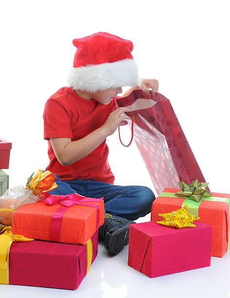 Cheerful boy in Santa Claus hat stock photo
