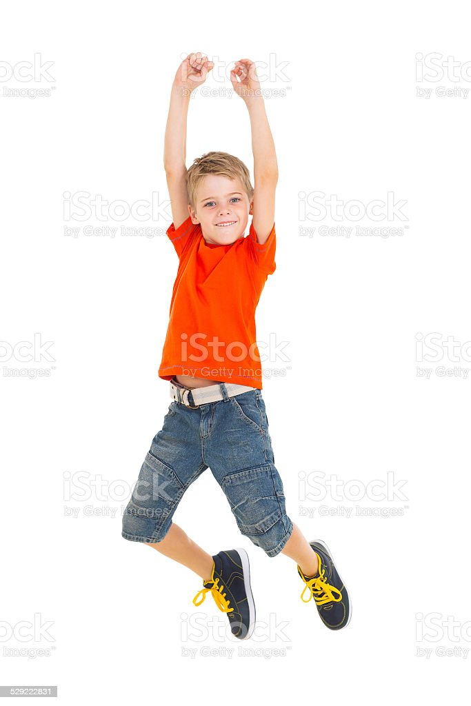 cheerful boy jumping stock photo