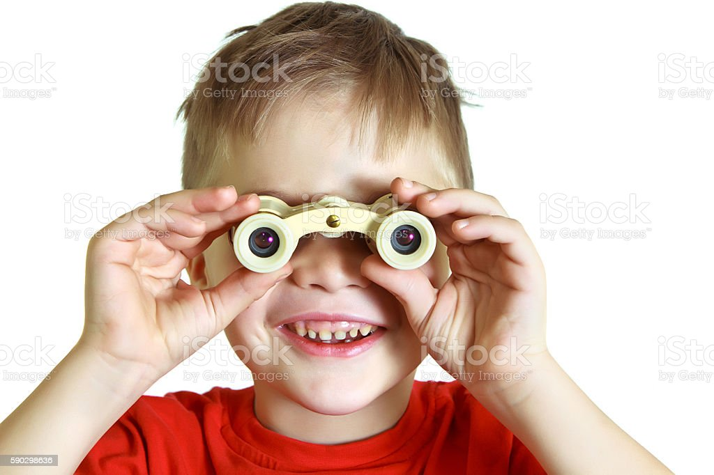 Cheerful boy looking through binoculars royaltyfri bildbanksbilder