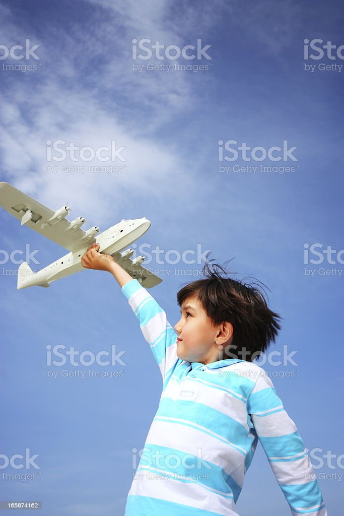 Cheerful boy playing with toy aeroplane royalty-free stock photo