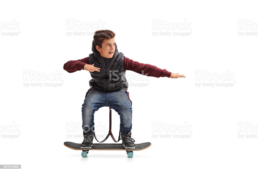 Cheerful boy riding a skateboard stock photo