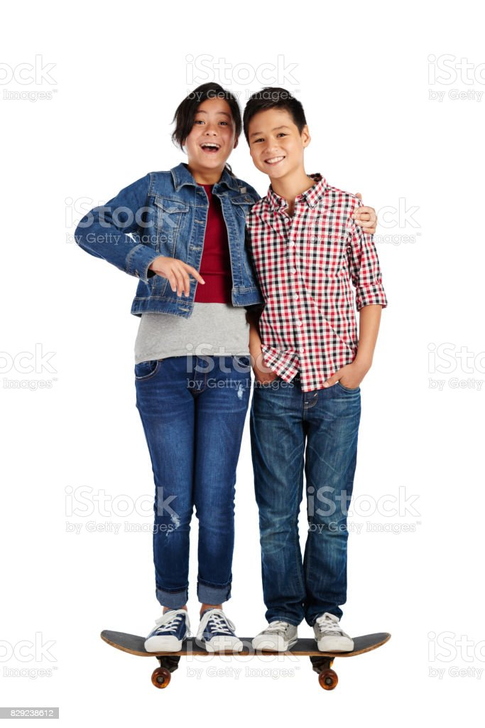 Cheerful brother and sister stock photo