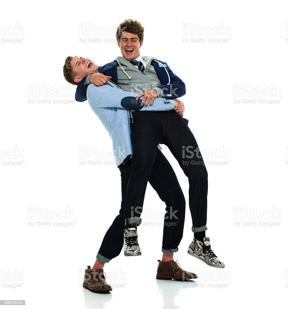 Cheerful brothers carrying foto royalty-free