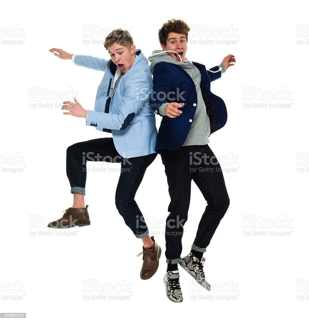 Cheerful brothers jumping stock photo