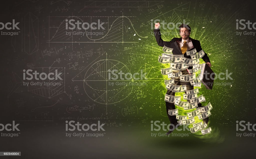 Cheerful businesman jumping with dollar banknotes around him stock photo