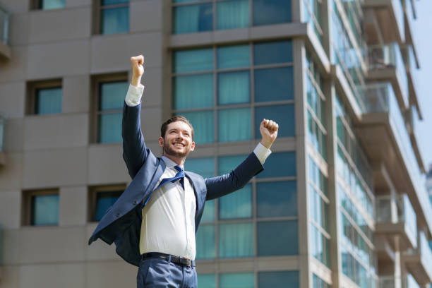 Cheerful Business Man Celebrating Success Outdoors stock photo