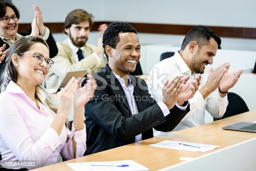 istock Cheerful business people clapping in conference 1068445352