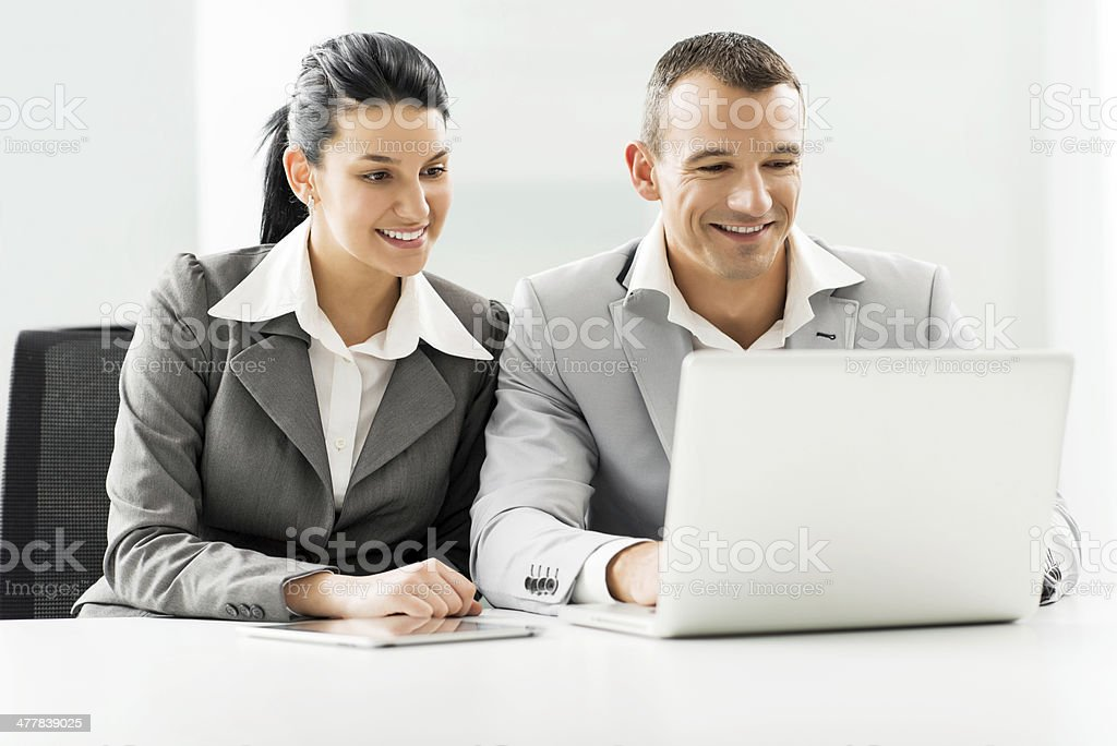 Cheerful business people working together on laptop. royalty-free stock photo