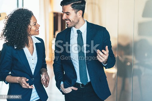 Cheerful business persons walking together