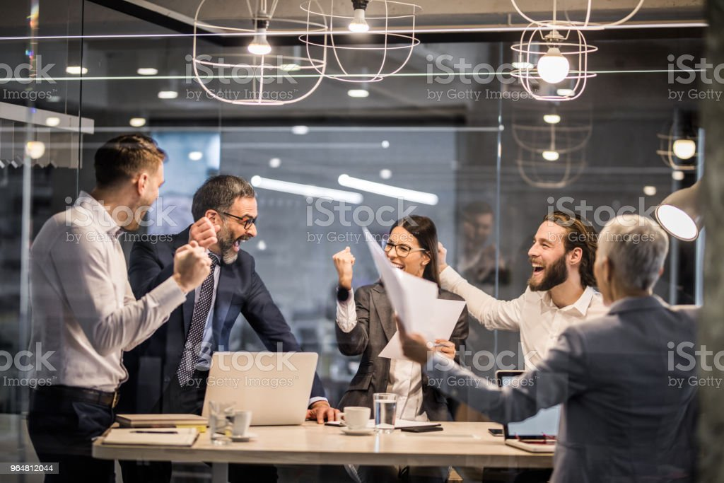 Cheerful business team celebrating their achievement in the office. royalty-free stock photo