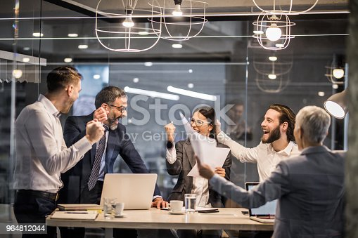 Cheerful Business Team Celebrating Their Achievement In The Office Stock Photo & More Pictures of Achievement