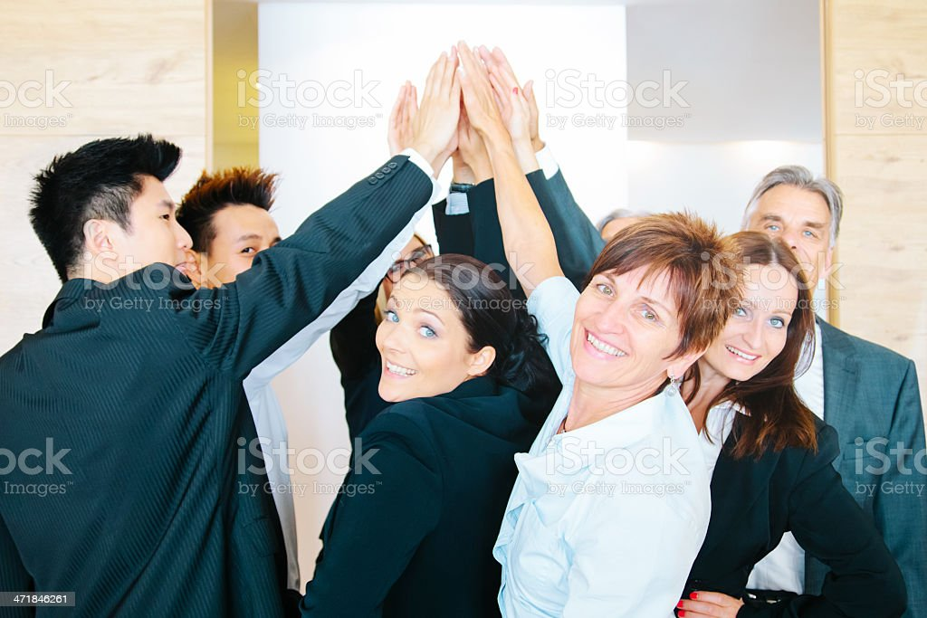 Cheerful Business Team Joining Hands royalty-free stock photo