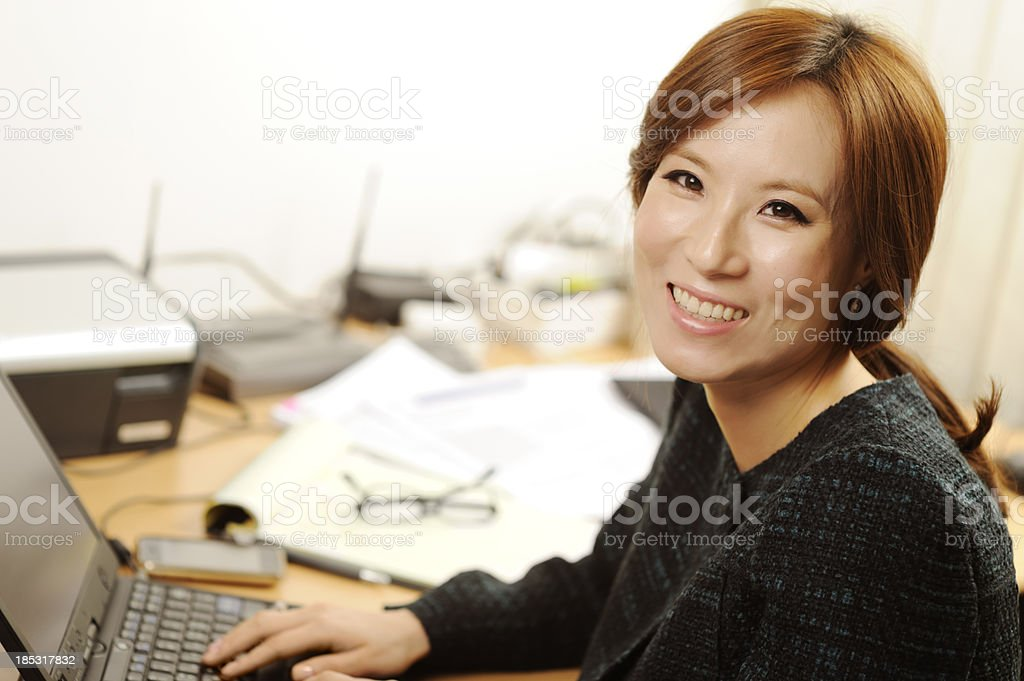 Cheerful business woman in the home office royalty-free stock photo