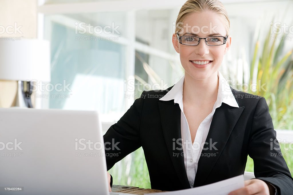 Cheerful business woman smiling stock photo