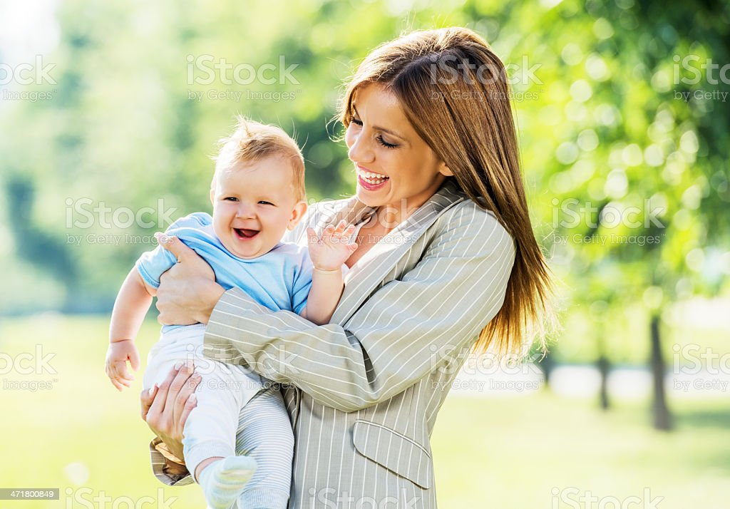 Cheerful business woman with her baby boy. royalty-free stock photo