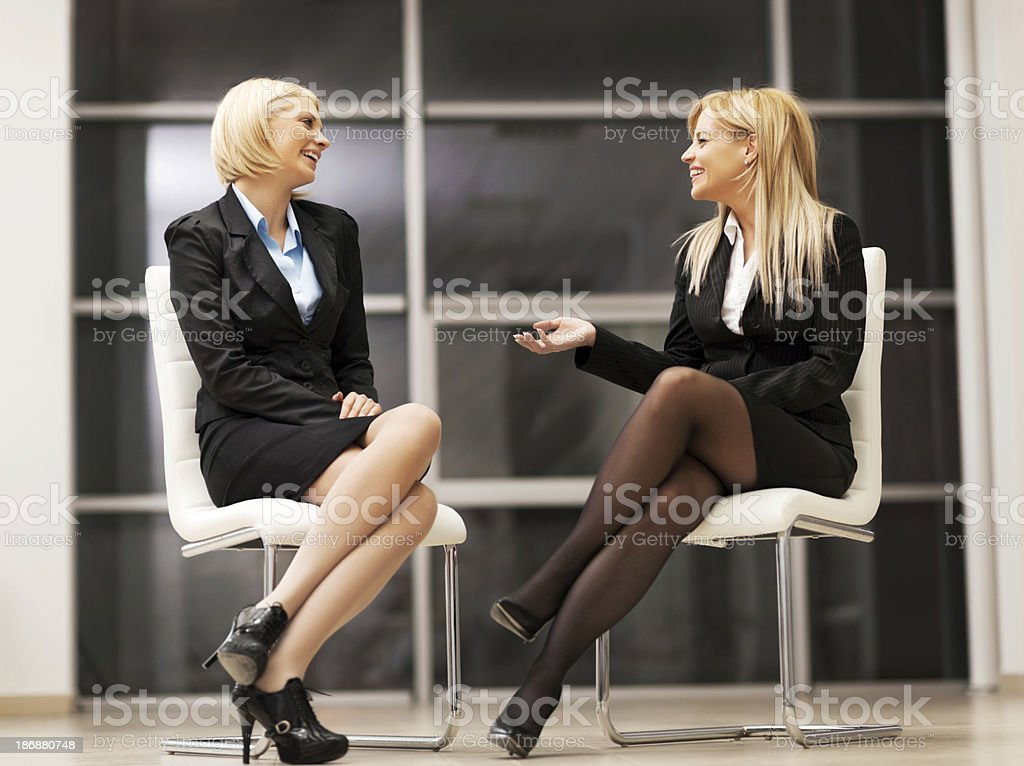 Cheerful business women talking. royalty-free stock photo