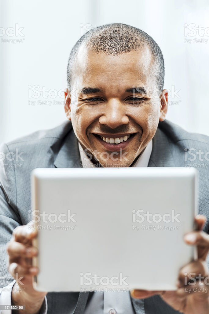 Cheerful businessman holding digital tablet. royalty-free stock photo