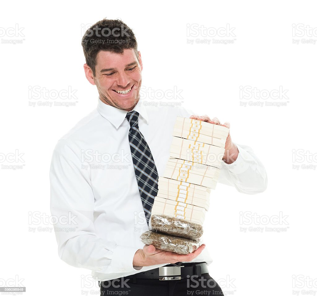 Cheerful businessman holding money and drug royalty-free stock photo