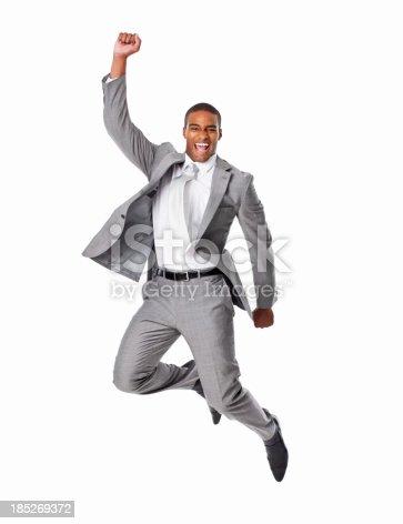 925466128istockphoto Cheerful Businessman Jumping - Isolated 185269372