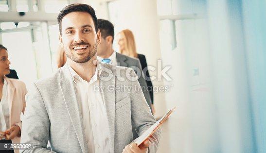 istock Cheerful businessman. 618963062