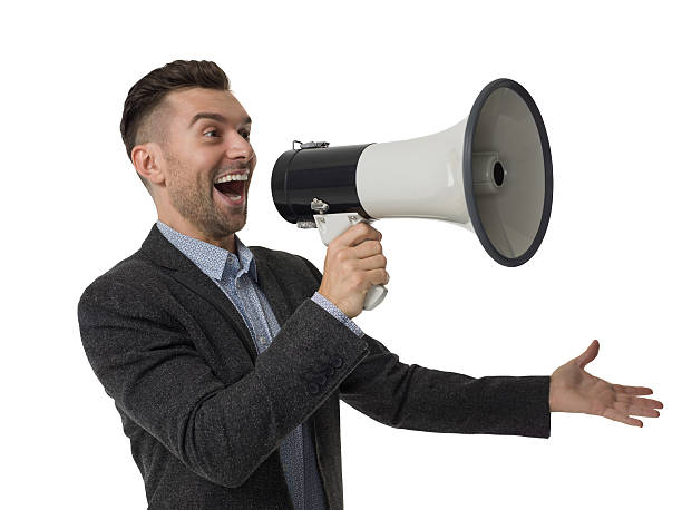 Cheerful businessman using megaphone isolated portrait stock photo