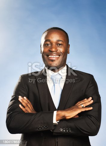 Happy businessman wearing a three-piece suit.