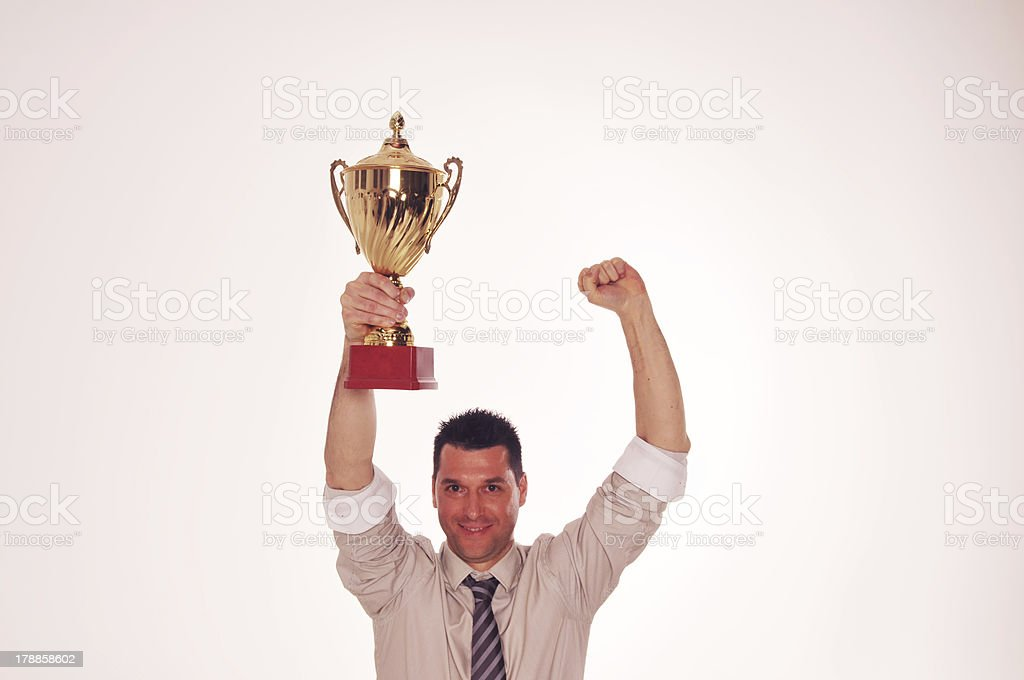 Cheerful businessman winning the cup. royalty-free stock photo