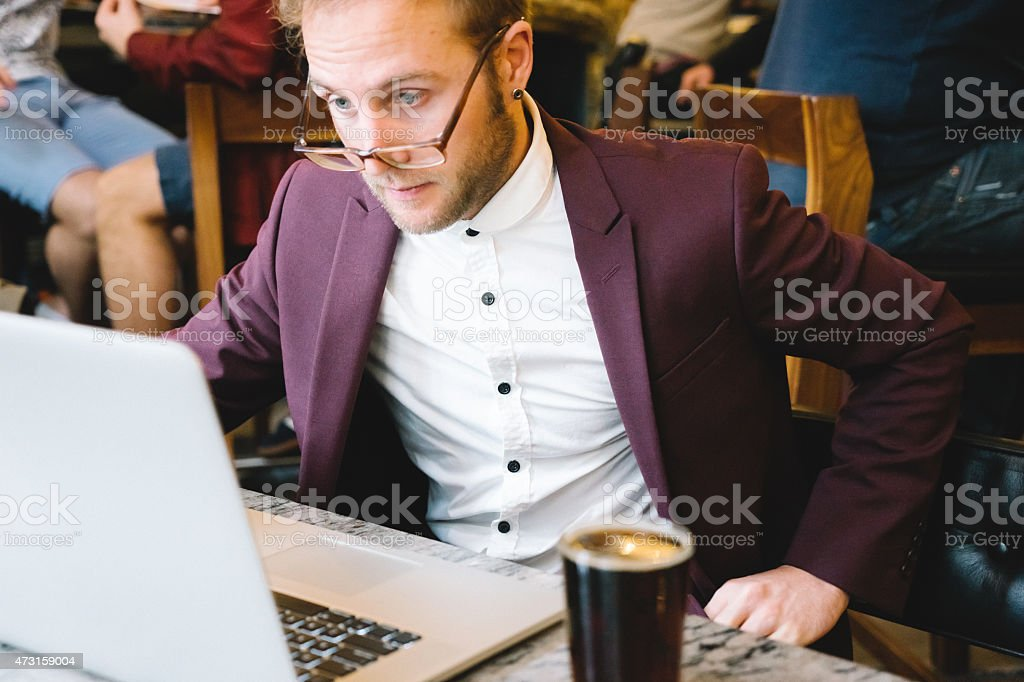 Cheerful Businessman Working In A Coffee Shop stock photo