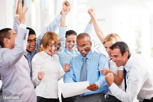 istock Cheerful businesspeople looking at the report. 184329036