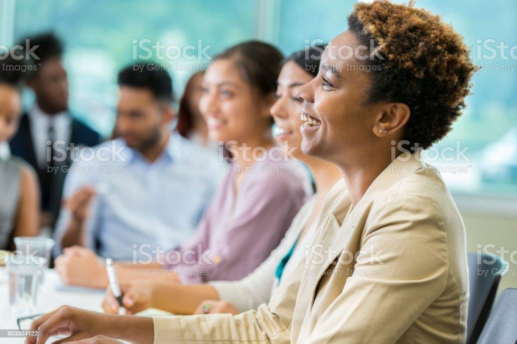 Cheerful businesswoman during seminar stock photo