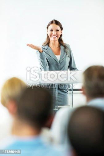 1180973515 istock photo Cheerful businesswoman having a public speech. 171369445