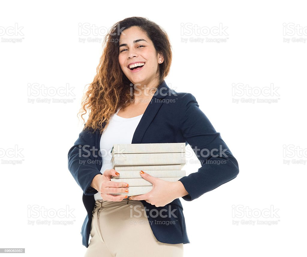 Cheerful businesswoman holding books royalty-free stock photo