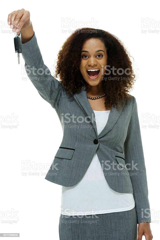 Cheerful businesswoman holding car key stock photo